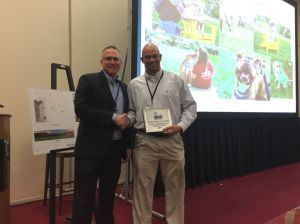 Chief Animal Control Officer Ed Jamison receives Bright Ideas Award from Michigan Humane Society President and CEO Matthew Peppers