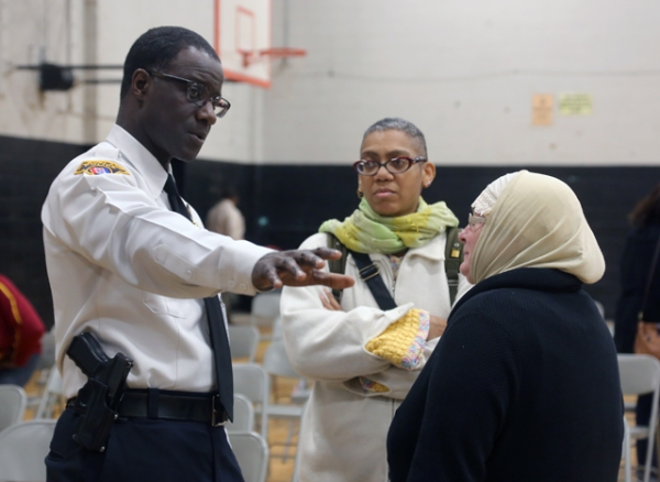 Police Chief Williams speaking with the public during a community meeting